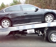 Altima on a tow truck