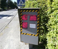 Pink spraypaint speed camera