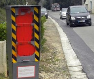 Red spraypaint on French speed camera