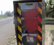 French speed camera spraypainted red