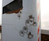Bullet holes in speed camera