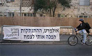 Anti-Olmert sign