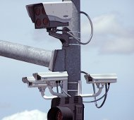 Red light cameras by etgeek/flickr
