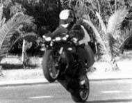 Wheelie motorcyclist